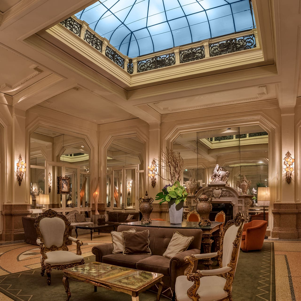 Interior image with stained glass ceiling and lounge hall in the Grand Hotel et de Milan