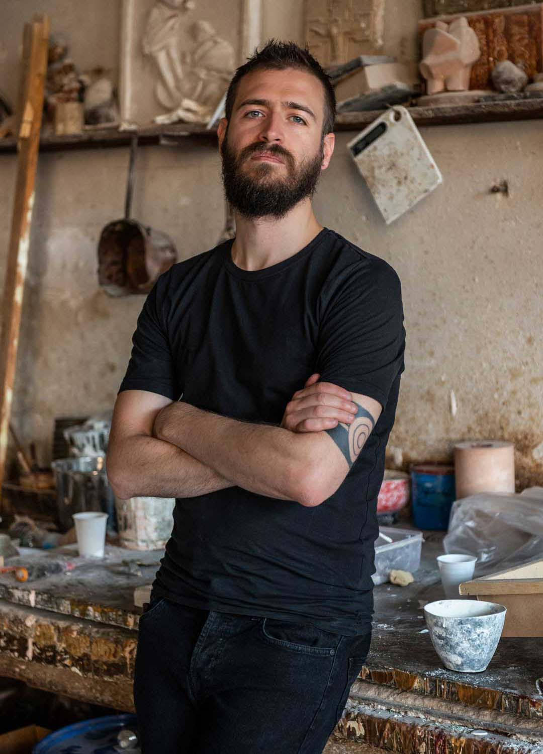 portrait of the designer federico villa dressed in a black tshirt and standing in a studio
