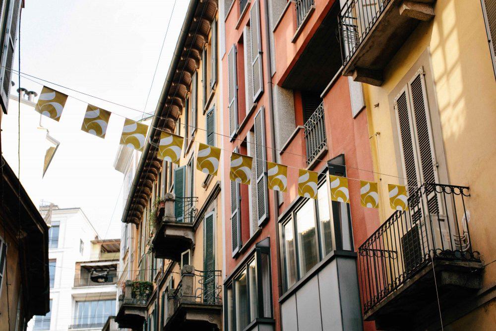 Italian street and Italian buildings with Flags across the street