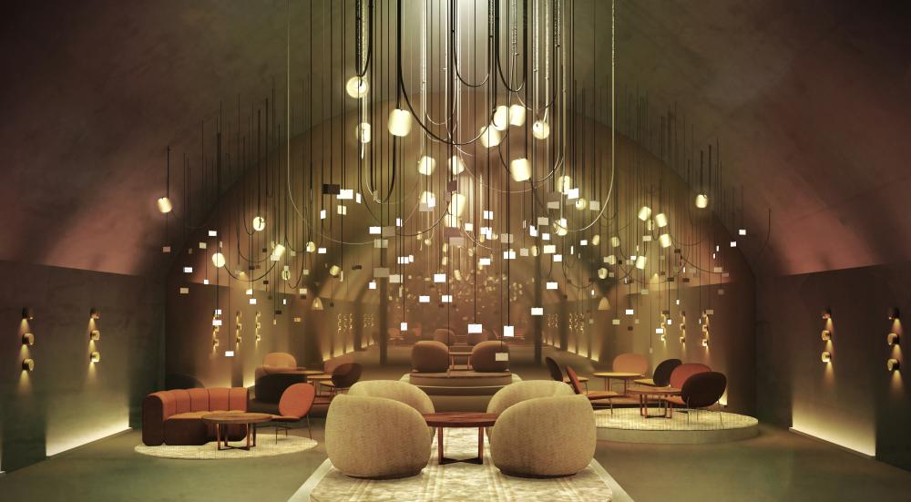 underground vault of central station in milan with lights hanging from the ceiling and designer armchairs