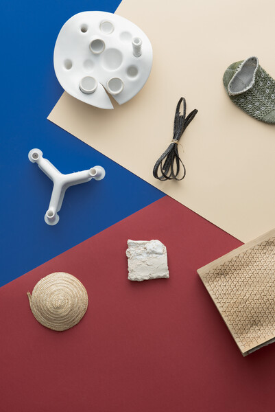 a variety of objects on top of red, blue, and beige colored papers