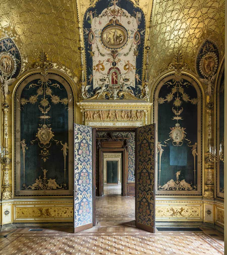 interior image of doorways in a palace decorated with floral patterns and gold ceilings and wooden parquet floors