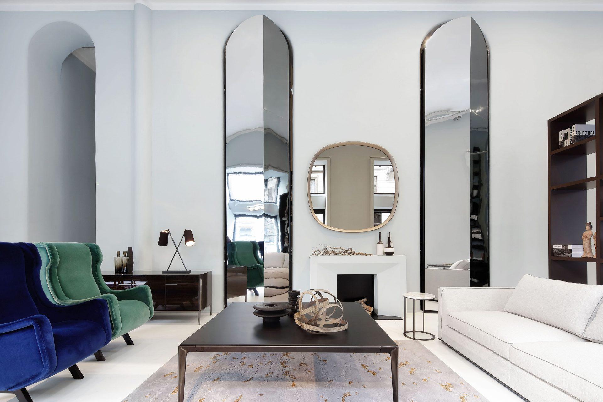 italian furniture showroom with green sofa and white sofa and carpet