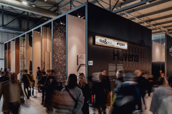 exterior booth of wall and deco and agape italian brands at salone del mobile 2019, people walking