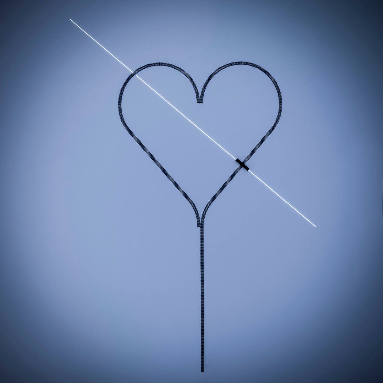 blue background with black heart outline with ray of light striking through horizontally