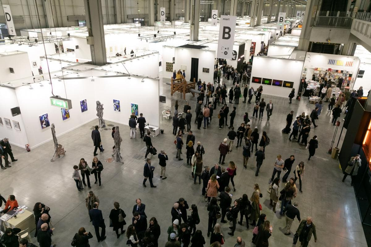 view of miart 2019 art fair from above showing people walking in the galleries