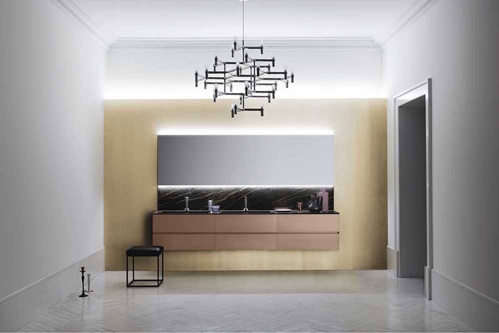 arbi bathroom furniture part of the best Italian sanitary brands displaying a suspended cabinet with marble backsplash and a big hanged mirror