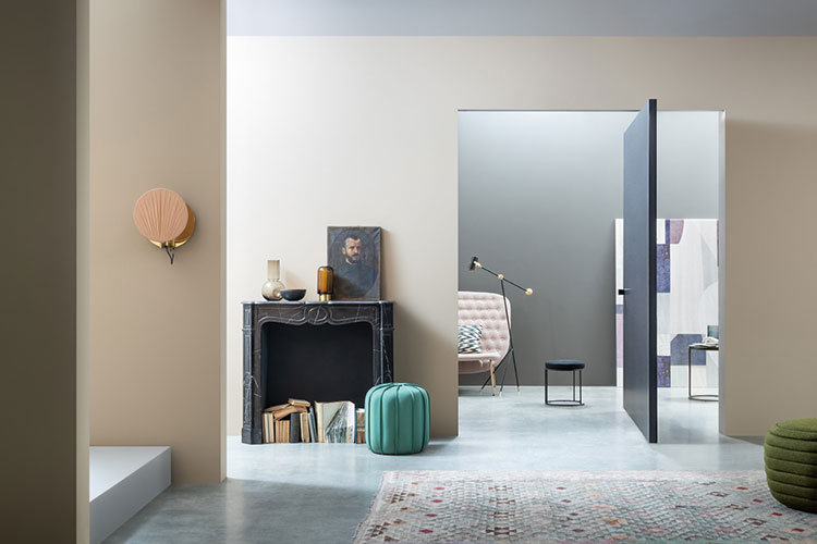 pivot door by lualdi model compass in a contemporary living room