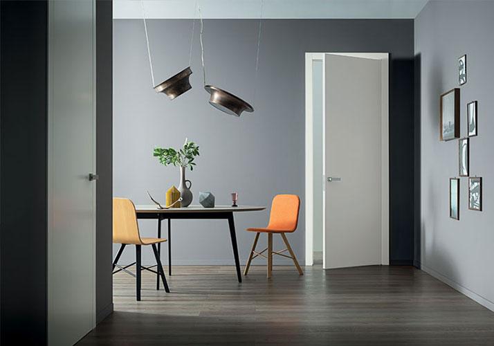 white door model lcd by lualdi best italian doors in a modern dining room
