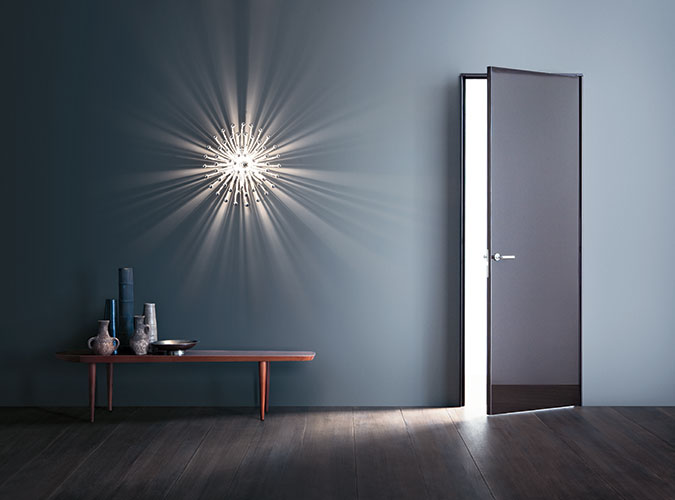 super door by lualdi with glossy surface in a modern coloured room