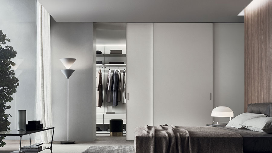 sliding doors as a partition between bedroom and dressing room by rimadesio the best italian doors manufacturer