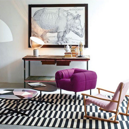 arflex pecorelle armchair in purple colour in an eclectic interiors living room