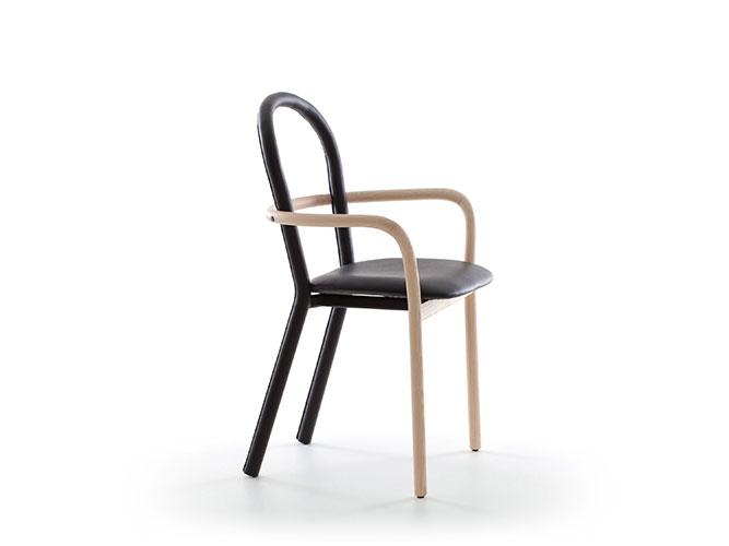gentle chair by porro furniture with wooden structure and seat in leather