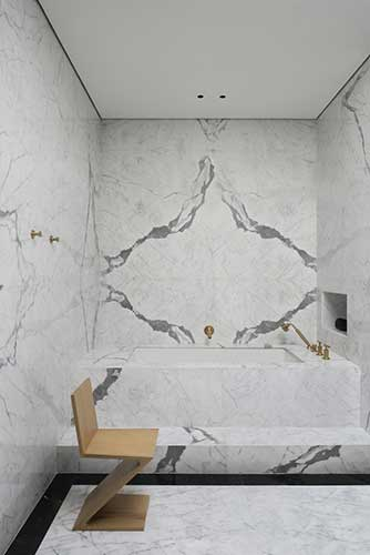 cassina zig zag chair in a modern bathroom covered with Italian marble designed by one of the best interior designer in Dubai