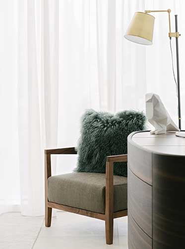 flexform armchair in a contemporary bedroom designed by one of the best interior designer in dubai