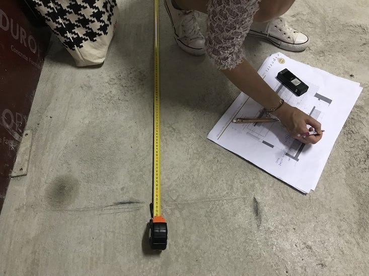 Italian interior designers taking measurements after having provided online interior design services