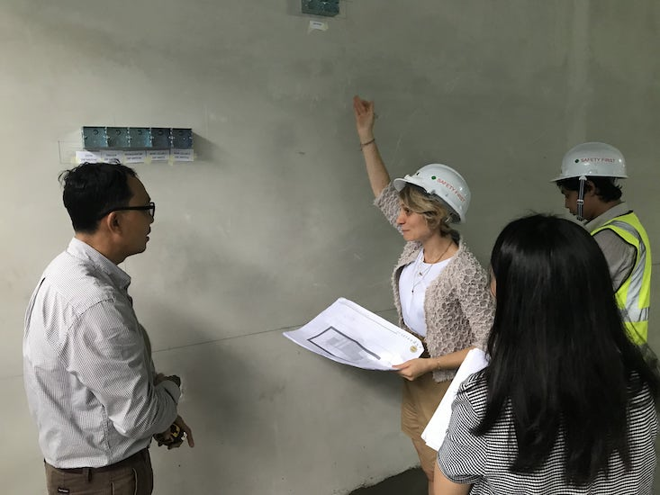Italian interior designers during a site survey after having provided one of the best online interior design service