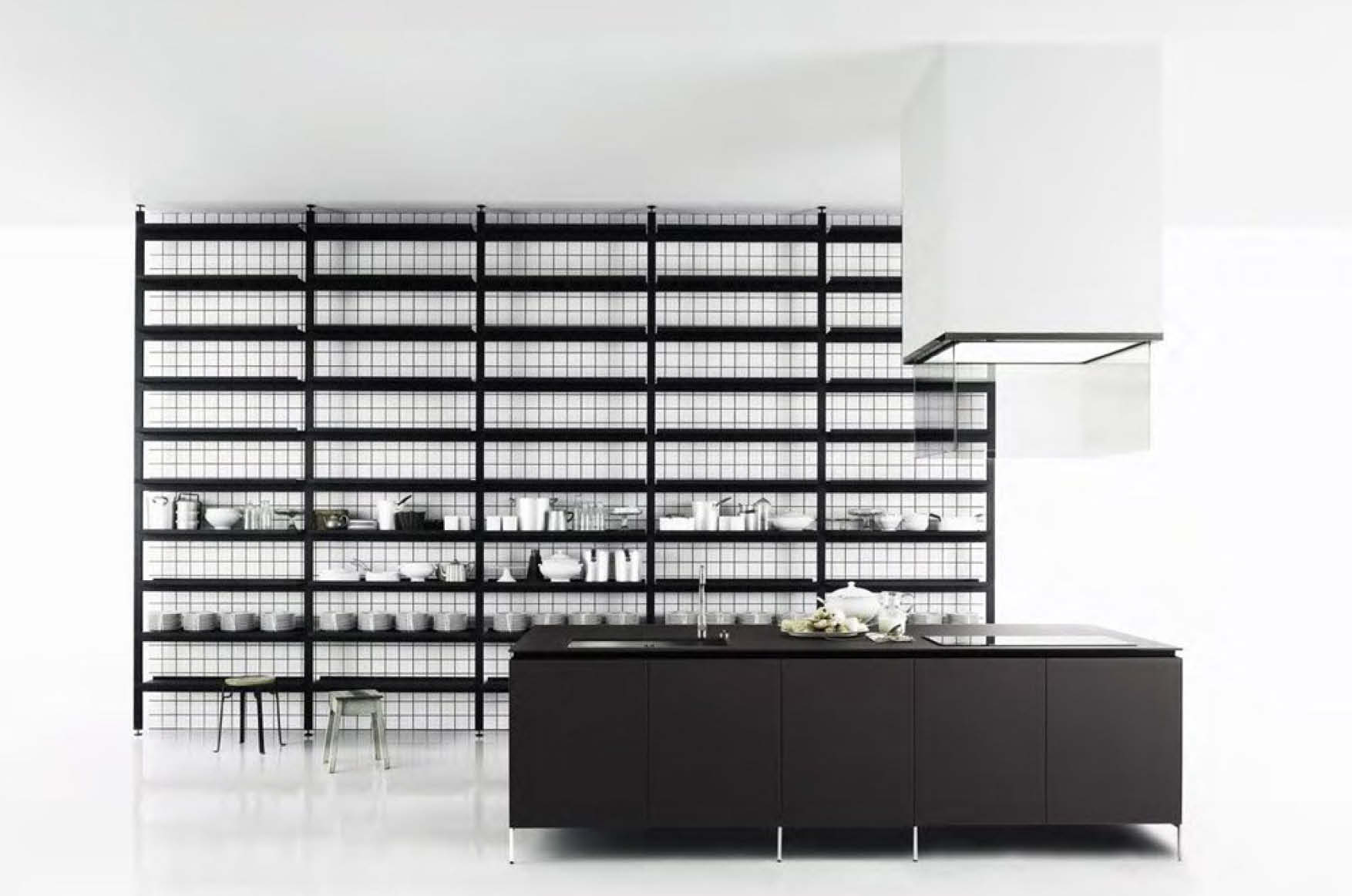 boffi xila kitchen with suspended black island with ceiling hood in front of a boffi shelf