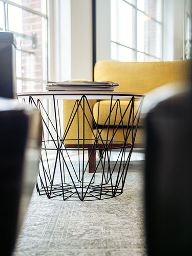 coffe table with metal structure used in a project where the client hire interior designer online