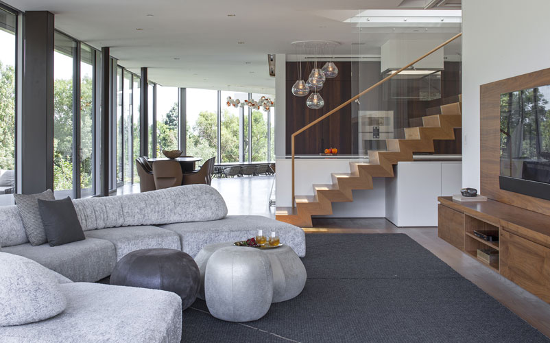 on the rock sofa by edra in a living open space designed by one of the top interior designers in los angeles