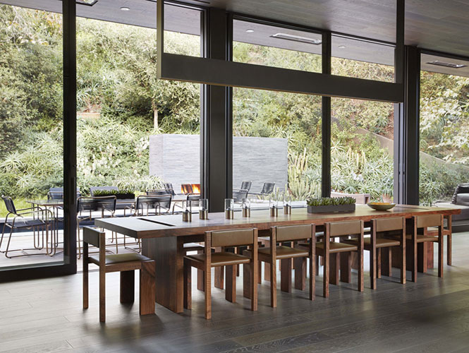 wooden dining table in a contemporary living room designed by one of the top interior design firms in los angeles