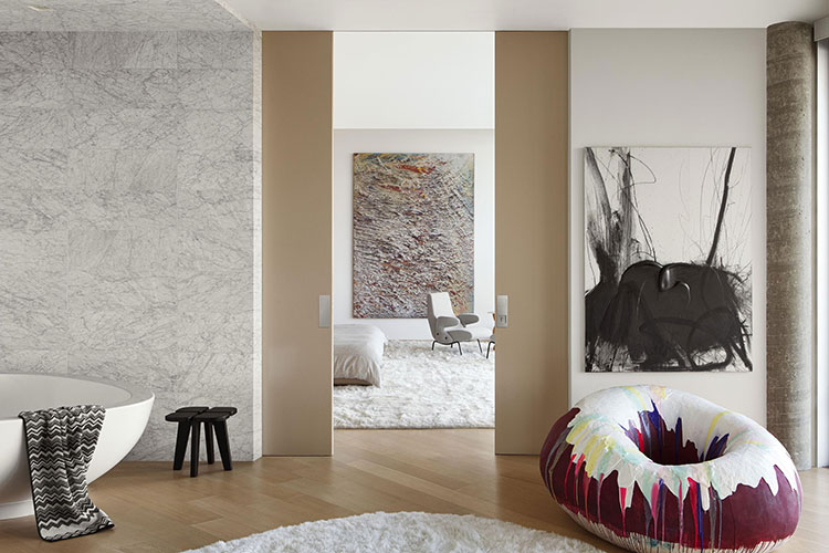 delfino armchair by arflex inside a bedroom designed by one of the top interior designers in los angeles