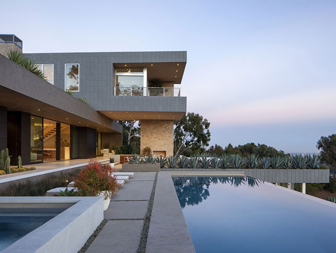 exterior of a villa with a pool designed by a high end interior designers in los angeles