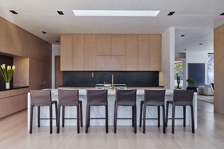 modern kitchen with cab stools by cassina chosen by one of the high end interior designer in los angeles