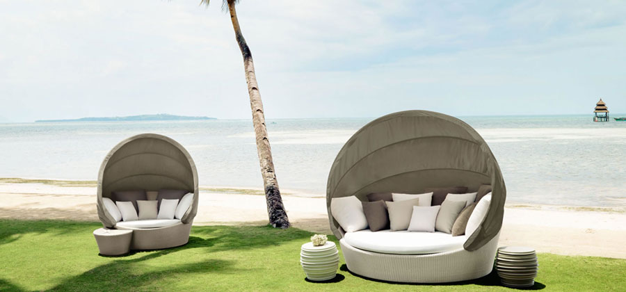 orbit by dedon, one of the best outdoor furniture brands, an outdoor lounge sofa with cover for the sun on the beach