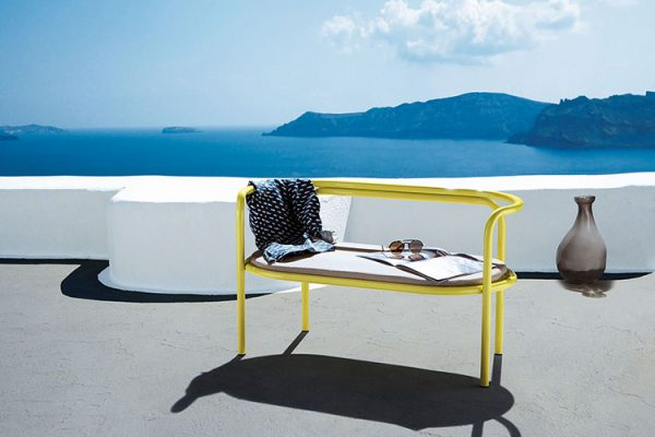 locus solus loveseat by exteta on a terrace with a seaview