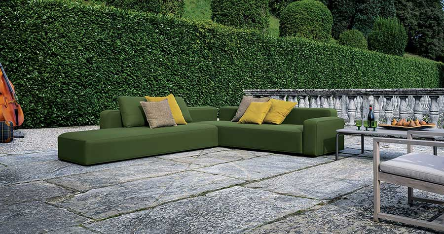 dandy sofa by Roda, an Italian outdoor furniture manifacturer, placed in a classic villa garden
