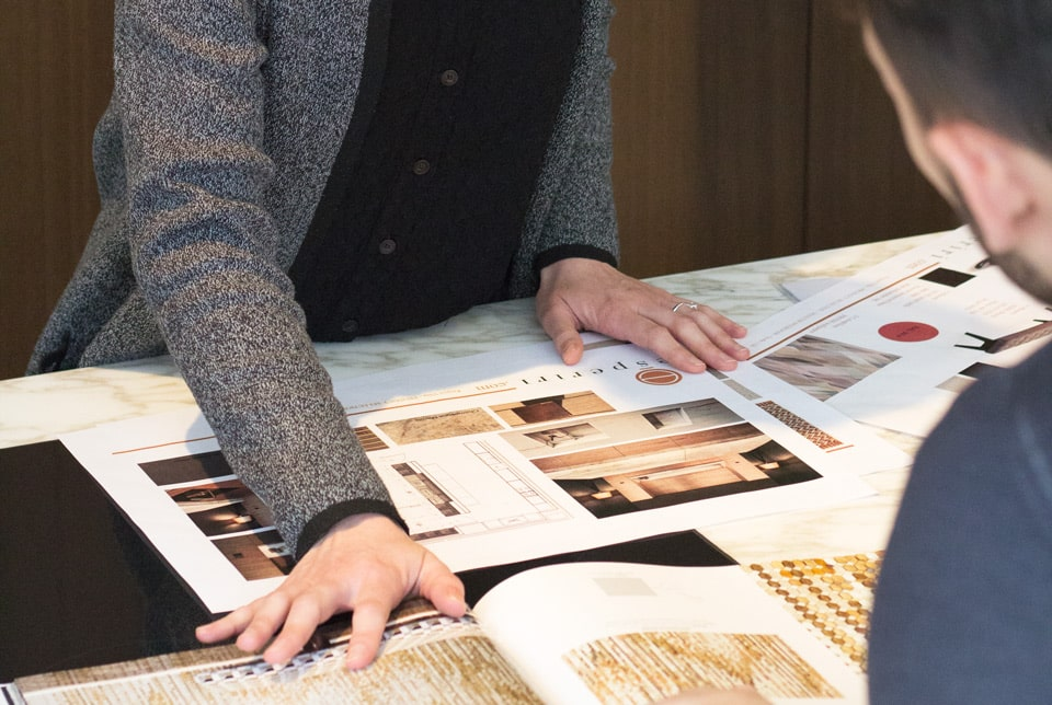Italian interior designers working on armani dada kitchen project in their atelier when they were hired for an interior design online assignment