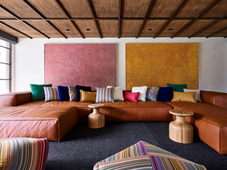 Australian Artworks, custom-made leather sofa and Italian Missoni cushions and footstools for this fusion style Lounge Area designed by Decus Interiors, one of the best interior designers Sydney has to offer