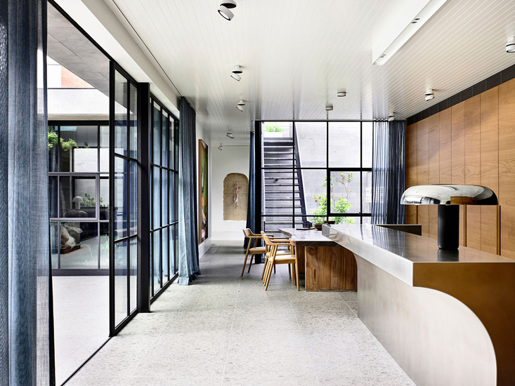 Large windows that illuminate St Vincents Place designed by BE Architecture, one of the best interior designers Melbourne has to offer