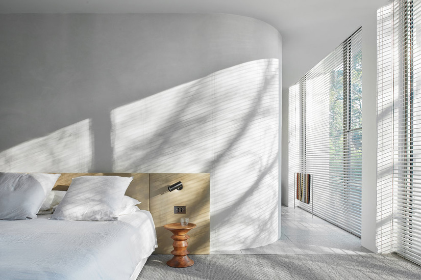 Minimal design and neutral palette for this bedroom designed by Davidov Architects in Melbourne