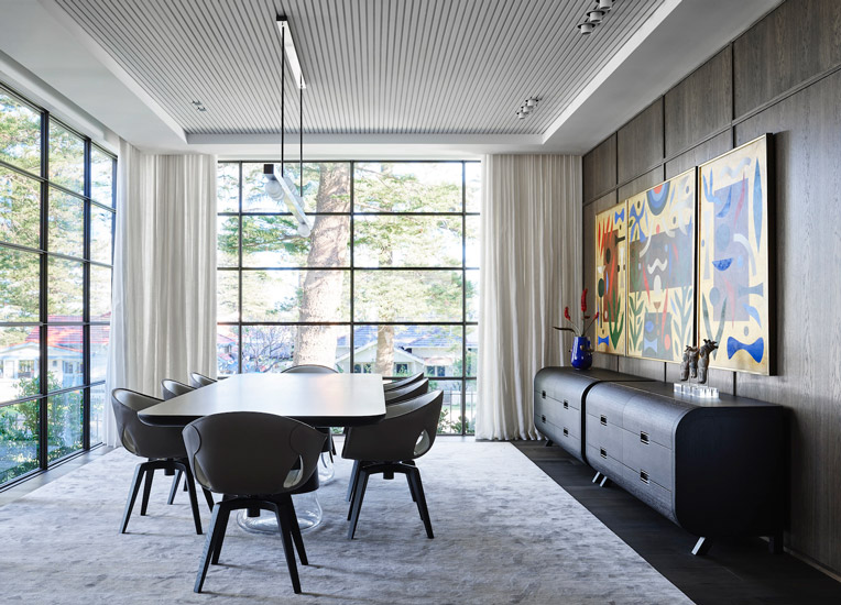Australian Artwork and Ginger Chairs by Roberto Lazzeroni for Poltrona Frau for this fusion style Dining room designed by Decus Interiors, one of the best interior designers Sydney has to offer