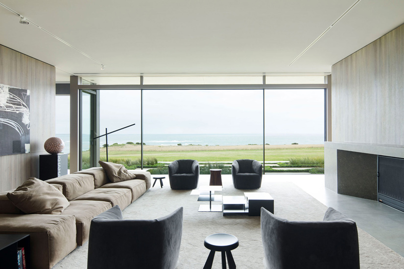 Minimalist Living Room with an amazing view on the ocean. Interior design by Carr, one of the best interior designers Melbourne has to offer