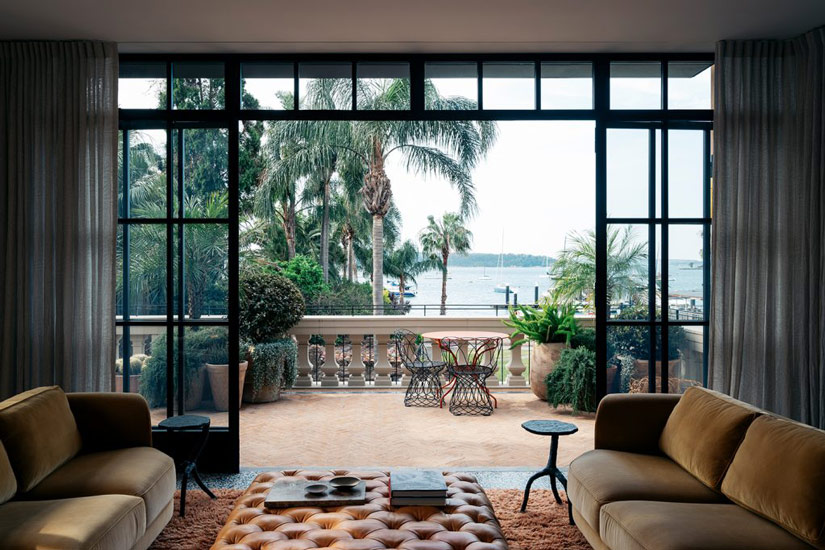 Elegant connection with the landscape: lounge area designed by Richard Stanish, one of the Design studios we selected in our list of the top interior designers Sydney has to offer