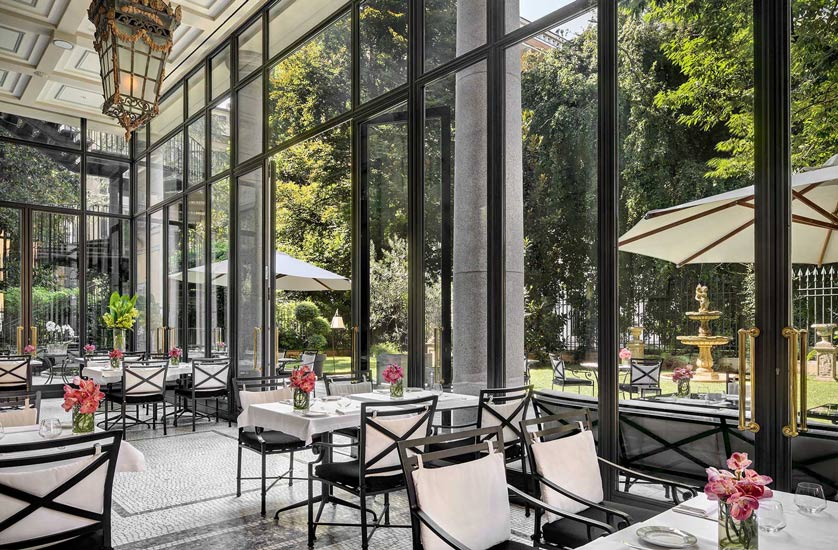 An enchanting garden room at Palazzo Parigi Hotel & Grand Spa, one of most precious hotel in our list of the best five stars hotels in milan.