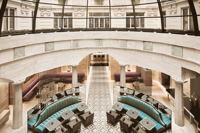 A lobby lounge with a standout 30-foot glass dome at Park Hyatt, one of the most fashionable hotel in our list of the best five star hotels in Milan by esperiri